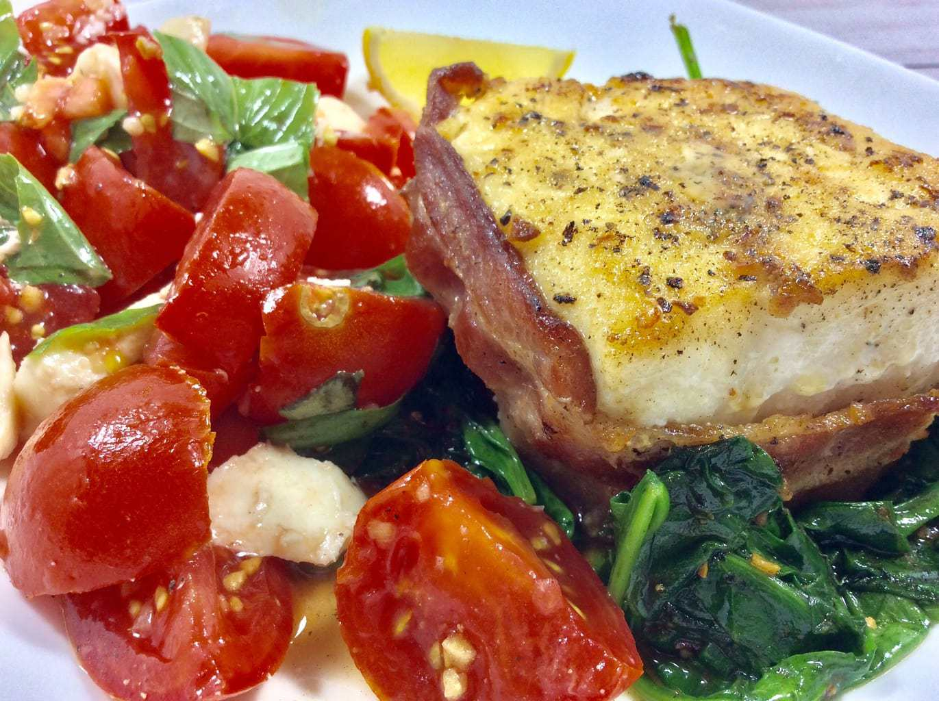 Bacon Wrapped Halibut over Spinach