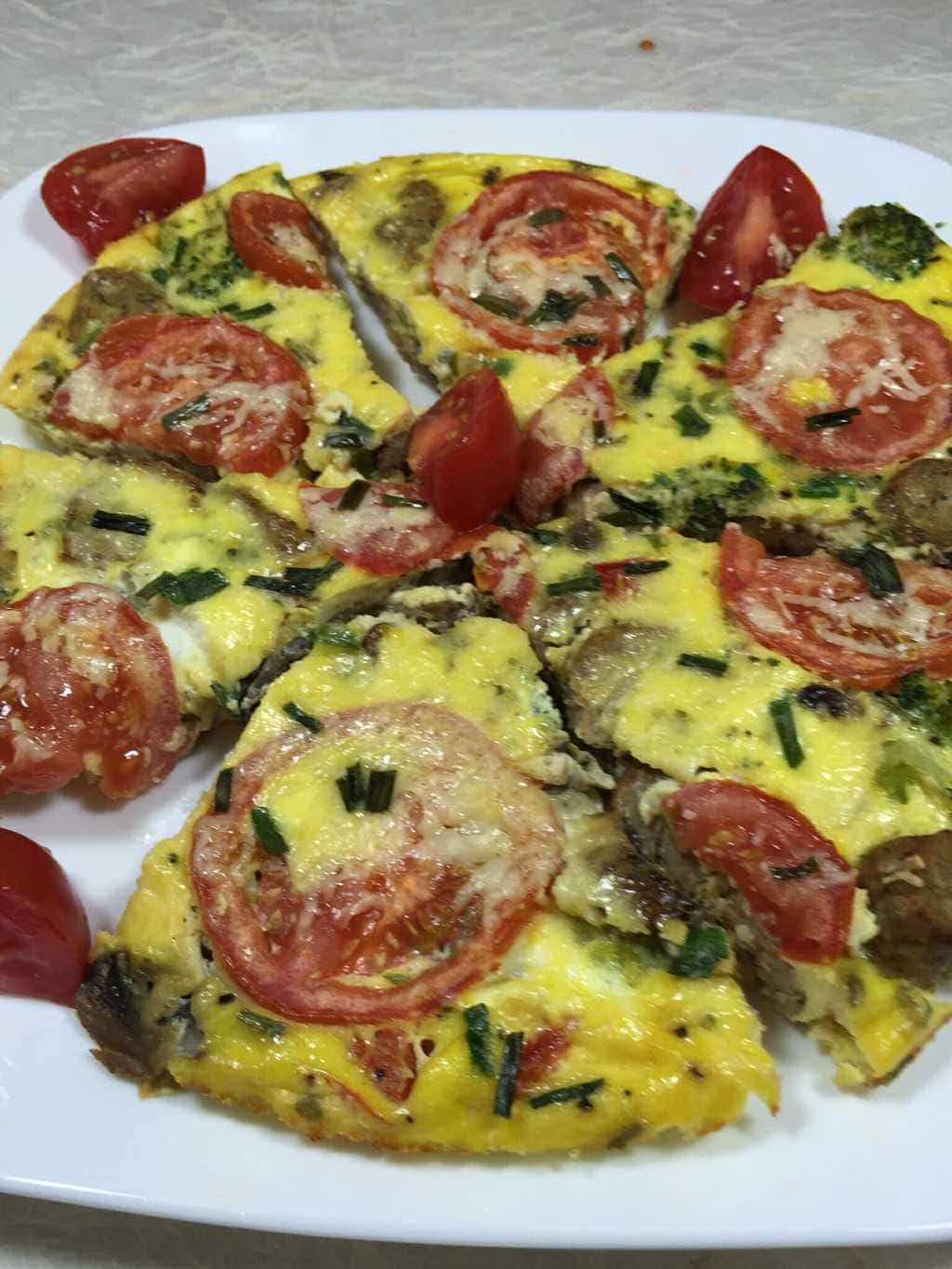 Vegetable and sausage Frittata on a white plate