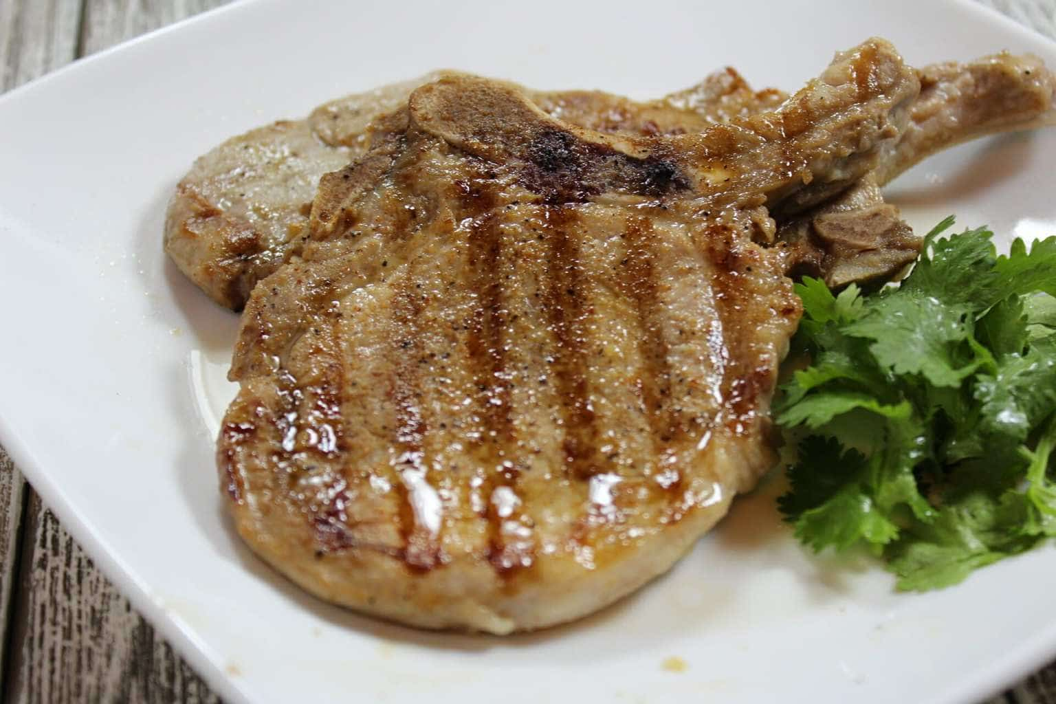 Grilled Pork Chops on a white plate.