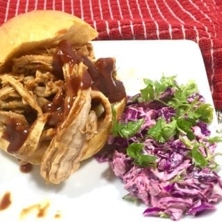 This Slow Cooked Sriracha BBQ Pork is perfect for the best spicy pork sliders you'll ever eat.And even better is how easy this recipe is to make.
