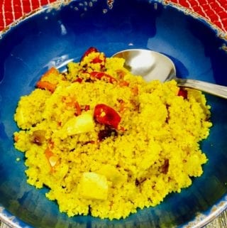 Curry Couscous and vegetables ina blue bowl