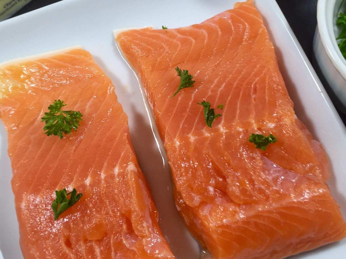 Fresh salmon on a white plate