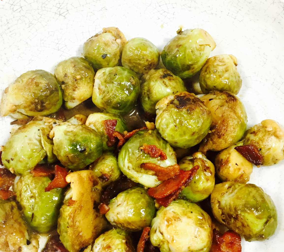 Cooked Brussels Sprouts with Bacon in a white bowl