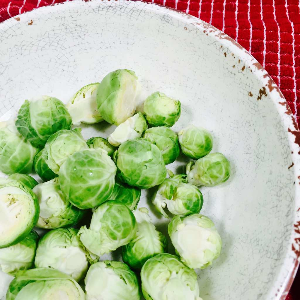 Raw Brussels Sprouts in a white bowl