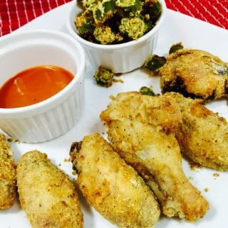 Crispy chicken wings with sauce and okra