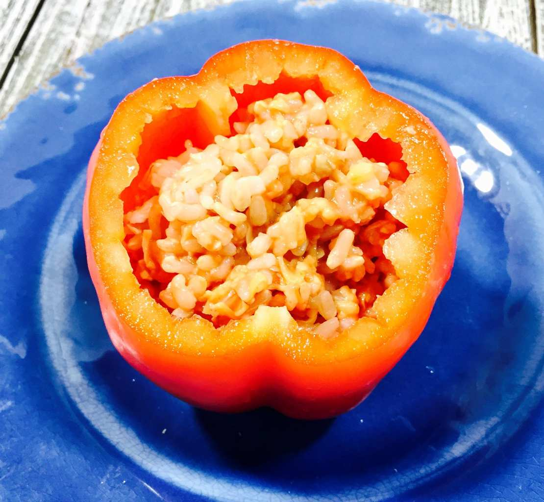 Stuffed pepper with rice on a blue plate