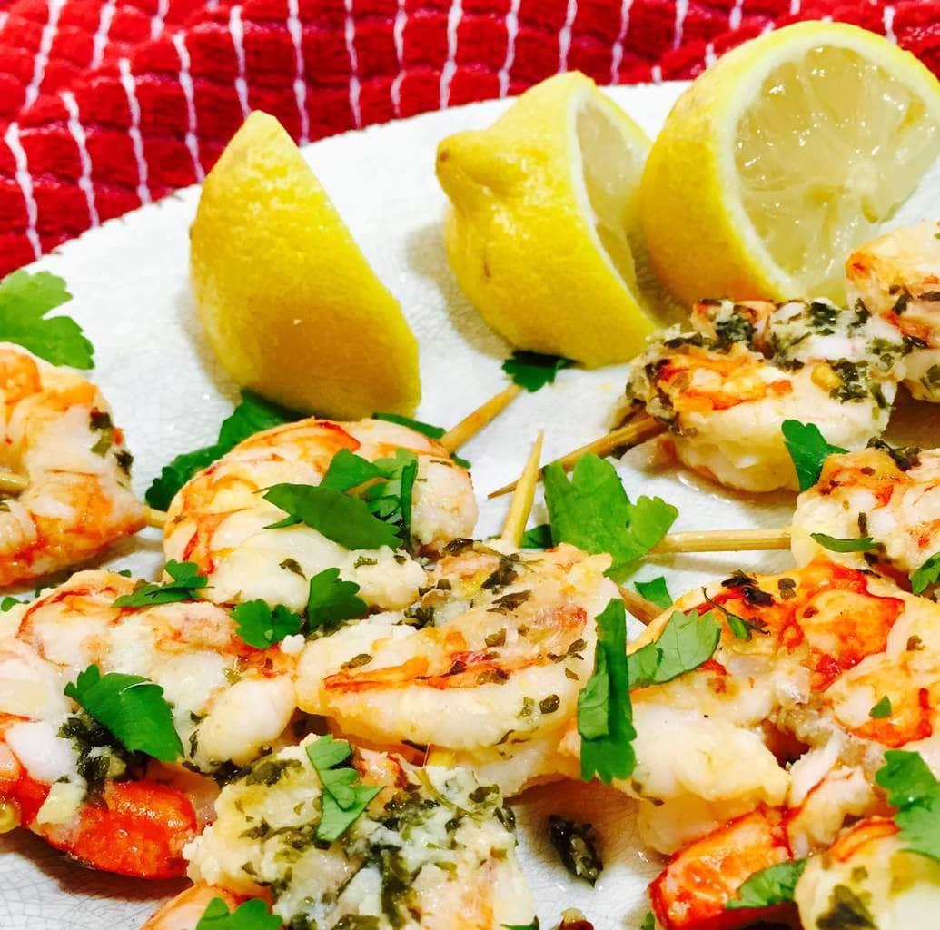 Shrimp Scampi and lemons on a white plate