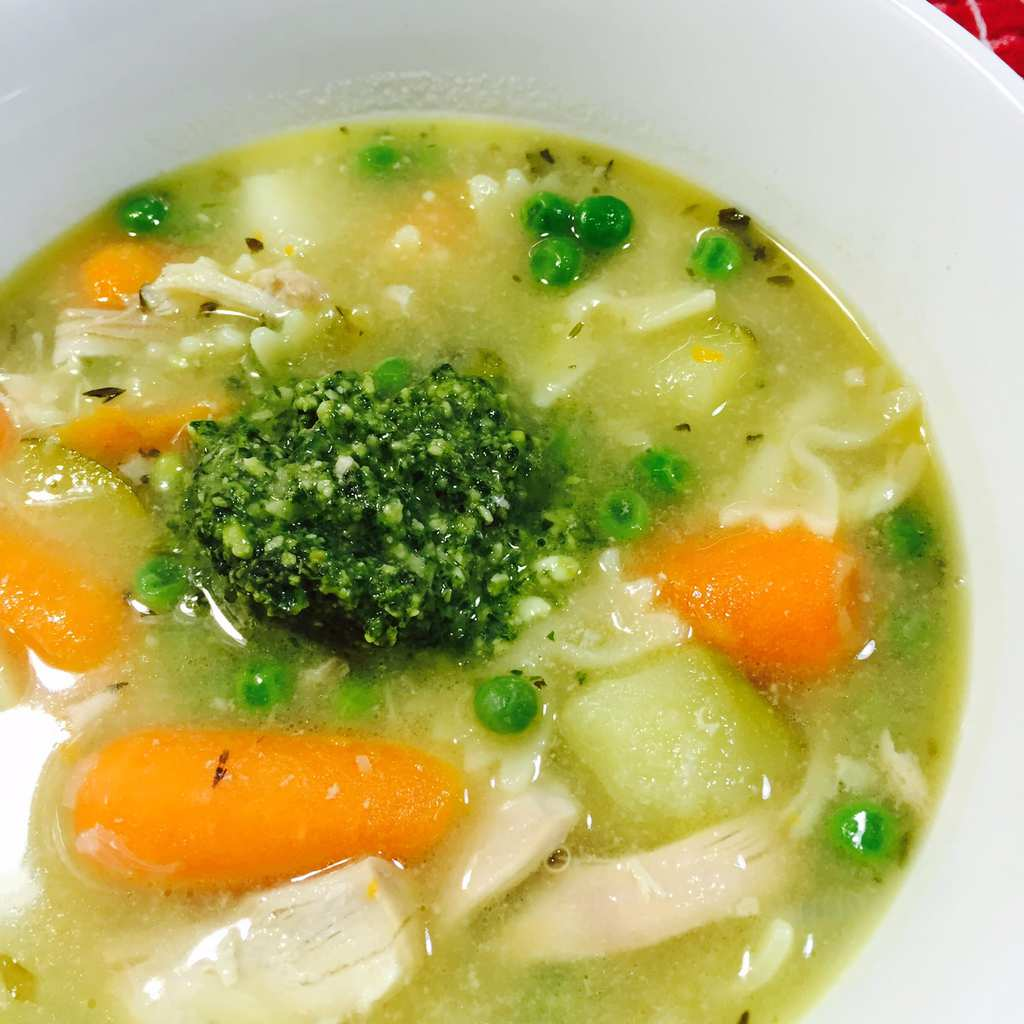 Chicken soup with Pesto in center