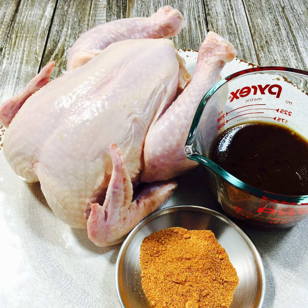 Raw chicken with marinade ingredients