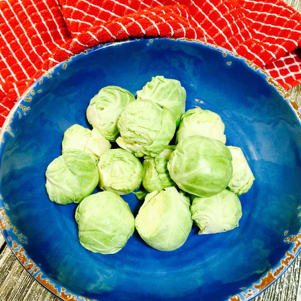 Brussels Sprouts in a blue bowl