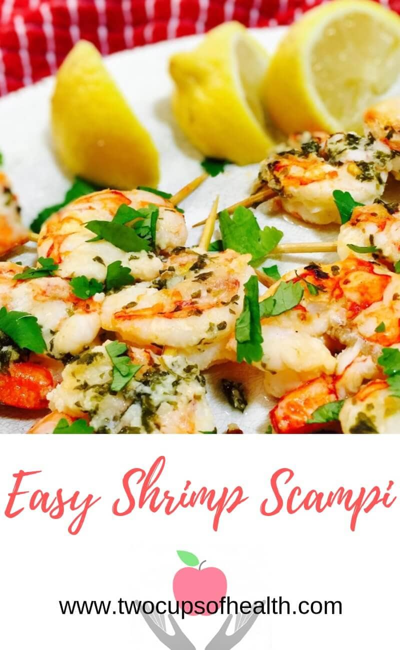 Shrimp Scampi on skewers on a white plate